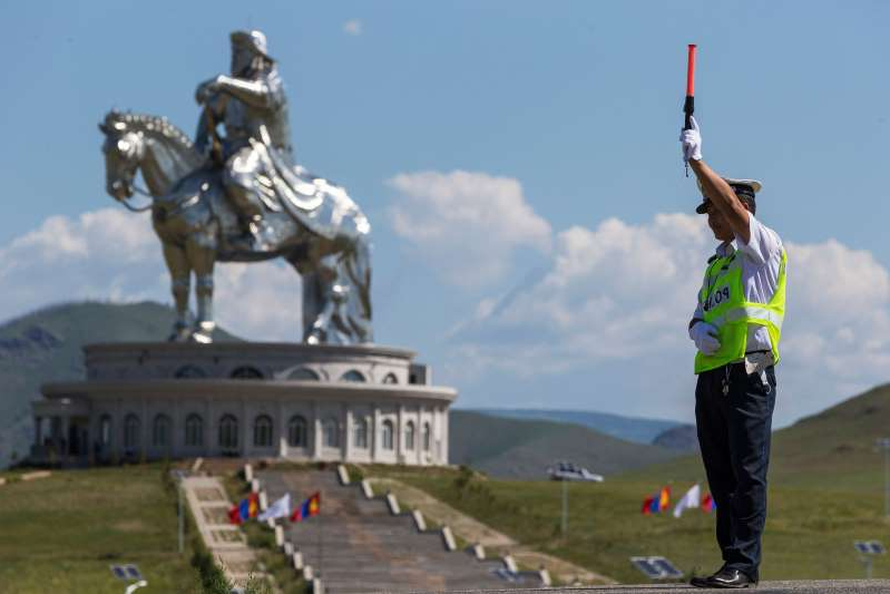 This file photo shows a Mongolian in front of the Genghis Khan statue in Tsonjin Boldog, Mongolia, on July 16 , 2016.