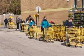 a group of people sitting on a cart: One in seven Canadian households are going hungry, according to a recent report by Community Food Centres Canada.