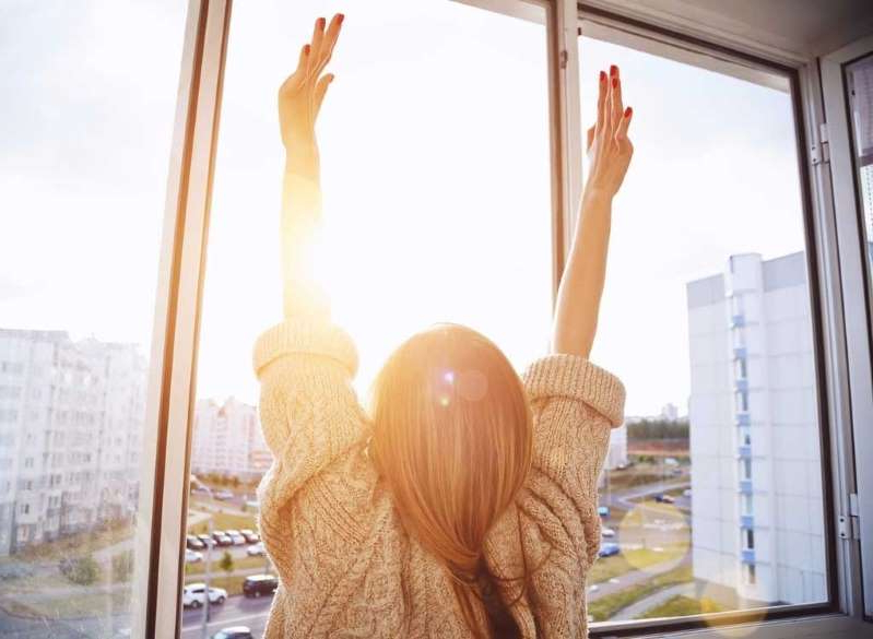 a person standing in front of a window: Sunrise morning motivation
