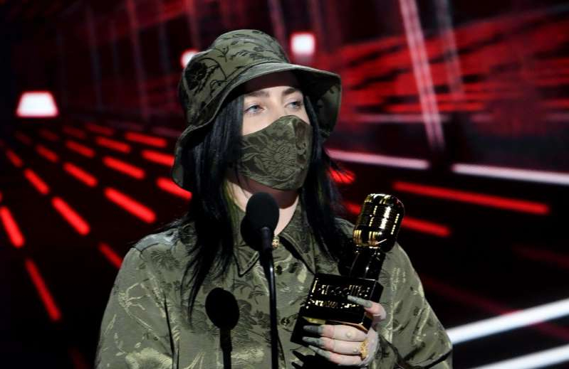 a person wearing a costume and holding a glass of wine: Billie Eilish at the Billboard Music Awards