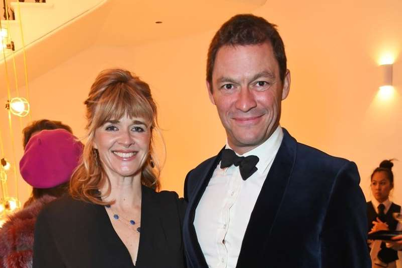 Dominic West and woman posing for the camera: Dominic West and Catherine Fitzgerald have headed to her ancestral castle after he was seen kissing Lily James