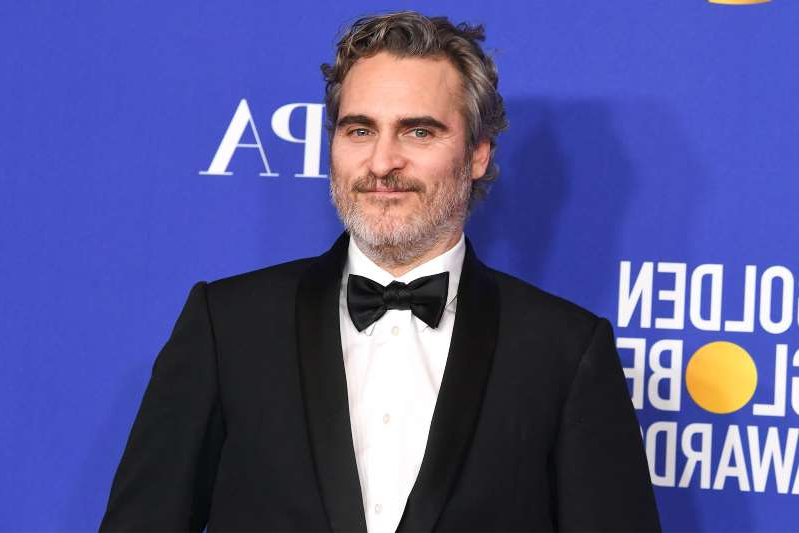 Joaquin Phoenix wearing a suit and tie: Kevin Winter/Getty Images