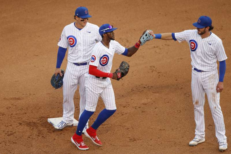 a group of baseball players standing on top of a dirt field: Whether you like them or not, baseball—especially during the playoffs—is more fun when the Cubs are involved. Overrated? A little. David Ross' squad is the best team in the worst NL division. Would I want my team facing them in the playoffs? Nope.