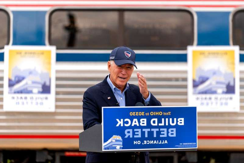 a man holding a sign: Democratic presidential candidate former Vice President Joe Biden speaks at Amtrak's Alliance Train Station, Wednesday, Sept. 30, 2020, in Alliance, Ohio. Biden is on a train tour through Ohio and Pennsylvania today. (AP Photo/Andrew Harnik)