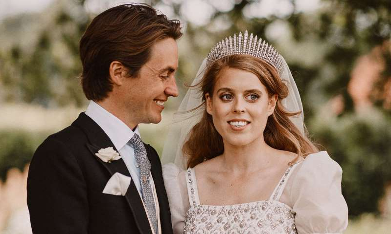 Princess Beatrice of York wearing a suit and tie: Hello! Magazine