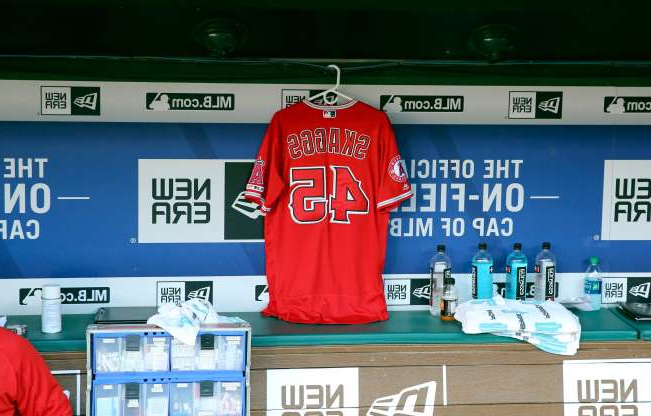 Slide 1 of 20: Skaggs' jersey hangs in the dugout on July, 2019, the day after his death.