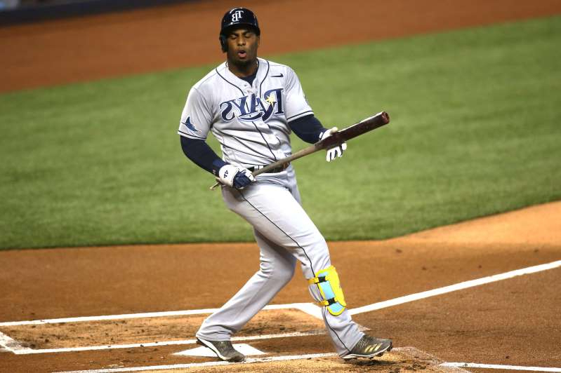 a baseball player holding a bat on a field: Yandy Diaz seemed to lose his cool a bit during Game 6.