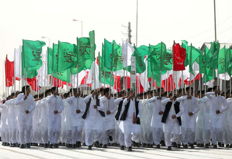 a group of people wearing costumes: Once the embargo ends, Iran will be legally able to buy and sell small arms, missiles, helicopters and tanks [File: Reuters]