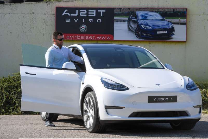 a man standing in front of a car: A picture taken on September 5, 2020 shows a driver testing a