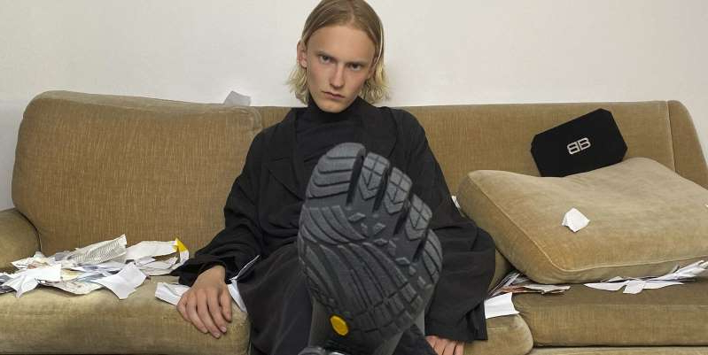 a person sitting on a couch: The brand collaborated with Vibram on three new styles, all incorporating the infamous, individual toe pockets
