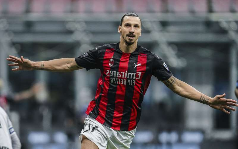 AC Milan's Zlatan Ibrahimovic celebrates after scoring scores his side's first goal during the Serie A soccer match between Inter Milan and AC Milan at the San Siro Stadium, in Milan, Italy, Saturday, Oct. 17, 2020. (Spada/LaPresse via AP)