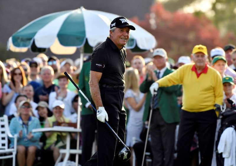 Gary Player standing in front of a crowd: Masters honorary starter Gary Player
