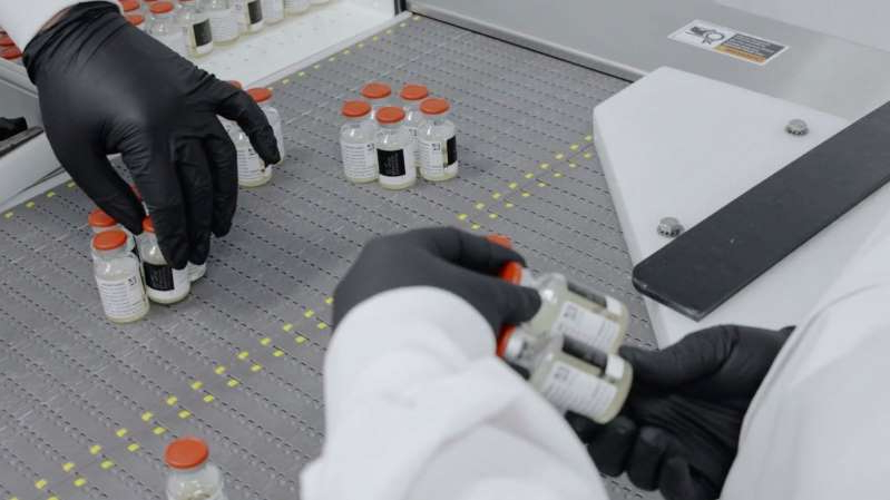 In this undated image from video provided by Regeneron Pharmaceuticals on Friday, Oct. 2, 2020, vials are inspected at the company's facilities in New York state, for efforts on an experimental coronavirus antibody drug.