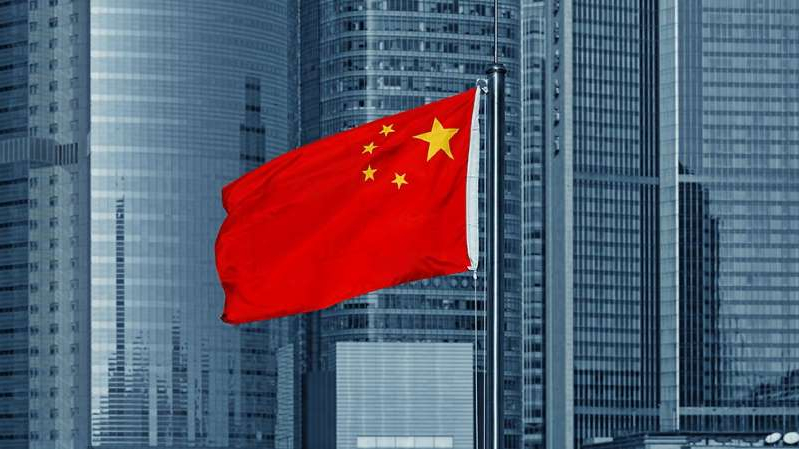 a flag on the side of a building: China warns it will detain American nationals following DOJ prosecution of Chinese scholars: report