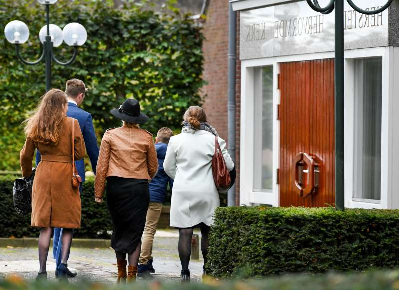 a group of people walking in front of a building: Spread of the coronavirus disease (COVID-19) in Staphorst