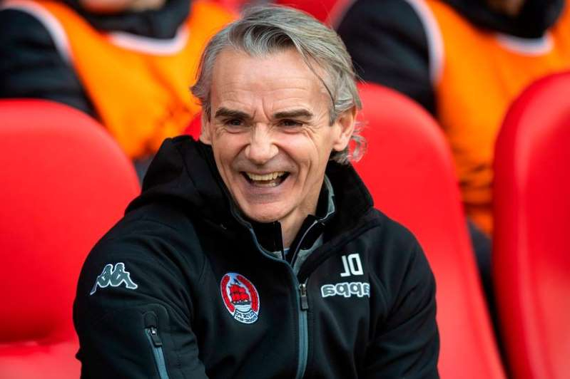 a person sitting in a chair: Clyde boss Danny Lennon is looking forward to the derby