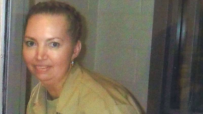 a person standing in front of a mirror posing for the camera: Lisa Montgomery, a federal prison inmate, is scheduled for execution on 8 December