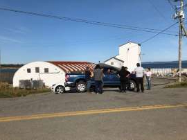 a truck is parked on the side of a road: A lobster pound in New Edinburgh, N.S., on Oct. 15, 2020, two days after it was swarmed and damaged.