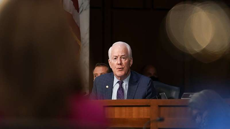 John Cornyn wearing a suit and tie: Changing suburbs threaten GOP hold on Texas