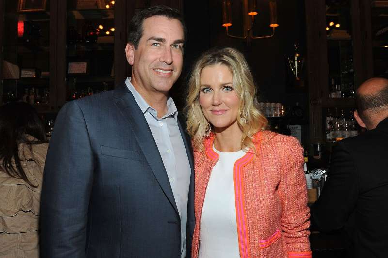 Rob Riggle and woman posing for a picture: Angela Weiss/Getty Images Rob Riggle and Tiffany Riggle