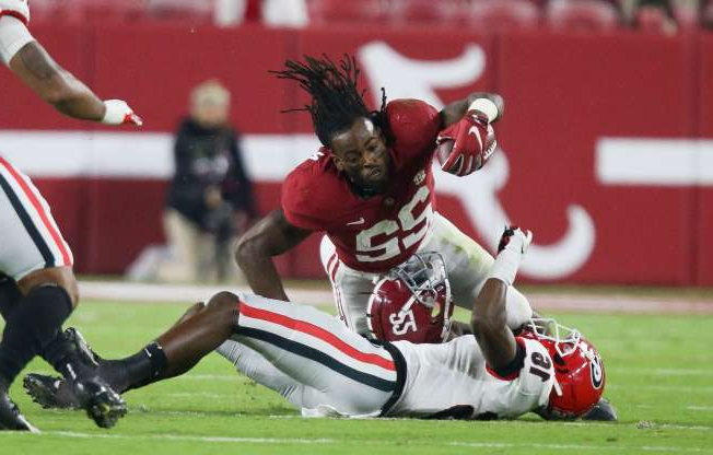 Slide 1 of 30: Alabama running back Najee Harris loses his helmet during the first quarter of the game against the Georgia Bulldogs at Bryant-Denny Stadium.