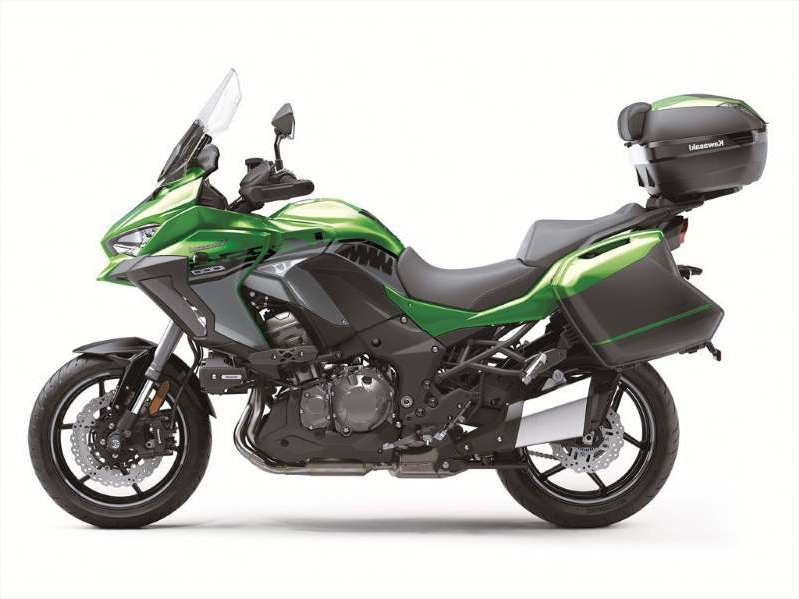 a green motorcycle parked on the side: Kawasaki Versys 1000 SE LT+