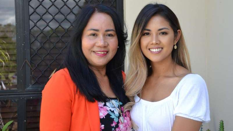 a woman posing for a picture: Monisa (left) has been teaching her mum Phay how to vote. (ABC News: Jessica Rendall)