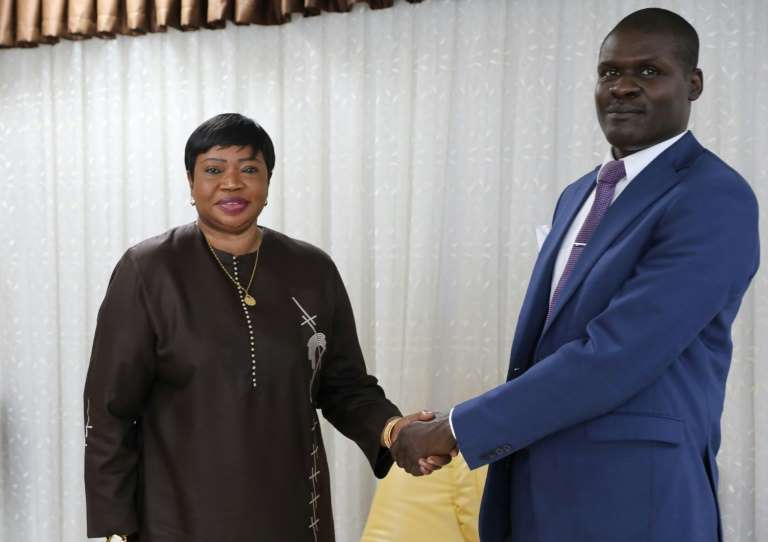 Fatou Bensouda in a suit standing in front of a curtain: International Criminal Court prosecutor Fatou Bensouda is in Sudan, where she met with Justice Minister Nasredeen Abdulbari on Sunday