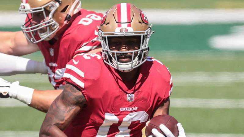 a close up of a man in a baseball game: Raheem Mostert will be sidelined at least three weeks.