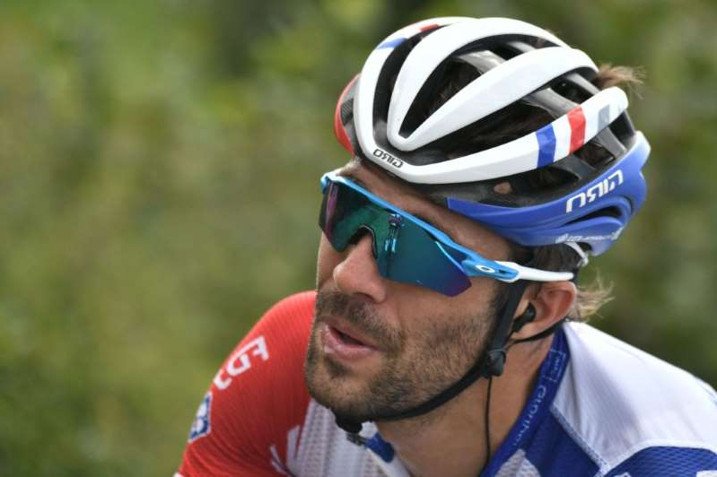 a close up of a man wearing a helmet: Team Groupama-FDJ rider France's Thibaut Pinot rides during the 13th stage of the 107th edition of the Tour de France cycling race 191 km between ChatelGuyon and Puy Mary on September 11 2020 Photo by Marco Bertorello AFP Photo by MARCO BERTORELLOAFP via Getty Images