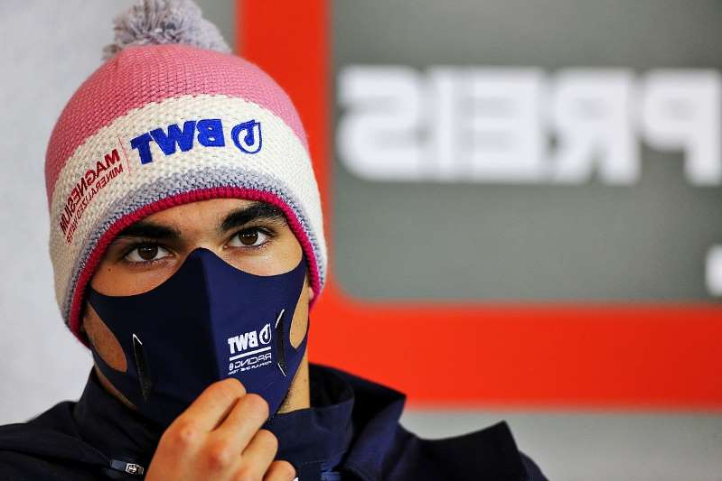 a close up of a person wearing a mask: FIA: Stroll illness hasn't exposed COVID test loophole