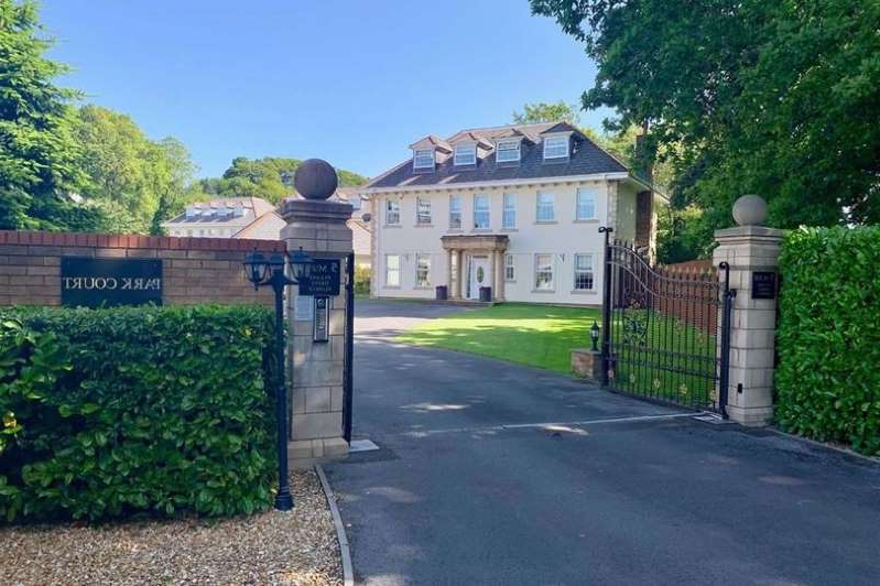a house that has a sign on the side of a road: Five bed modern mansion in the exclusive 5 house estate called Cwrt Ty Gwyn at Llangennech near Llanelli for sale for £680k