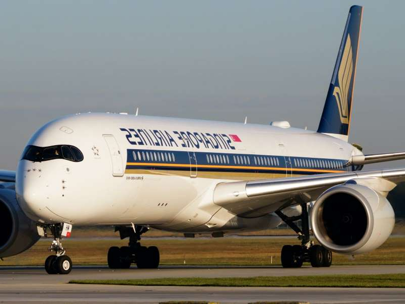 a large passenger jet sitting on top of a runway: Singapore Airlines will add its second non-stop route to the US during the pandemic when New York flights launch in November. Soos Jozsef/Shutterstock.com