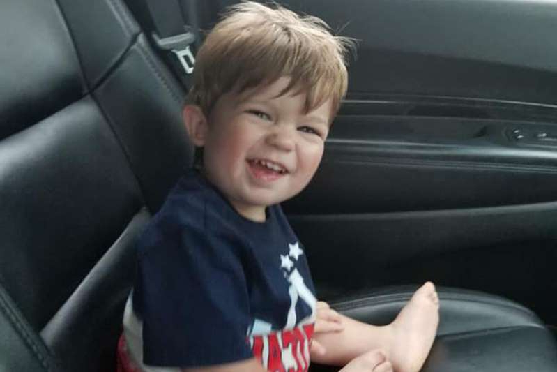 a little boy that is sitting on the seat of a car: Facebook Caleb Hopkins