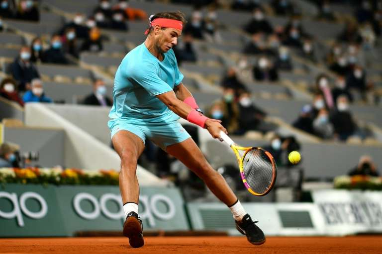 a man hitting a ball with a racket: Nadal has never won the Paris Masters
