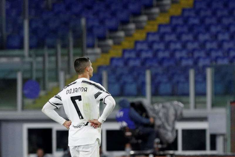 a man in a baseball game: Cristiano Ronaldo and other players who would have featured in this week's Champions League matches have tested positive for the coronavirus. (AP Photo/Gregorio Borgia)