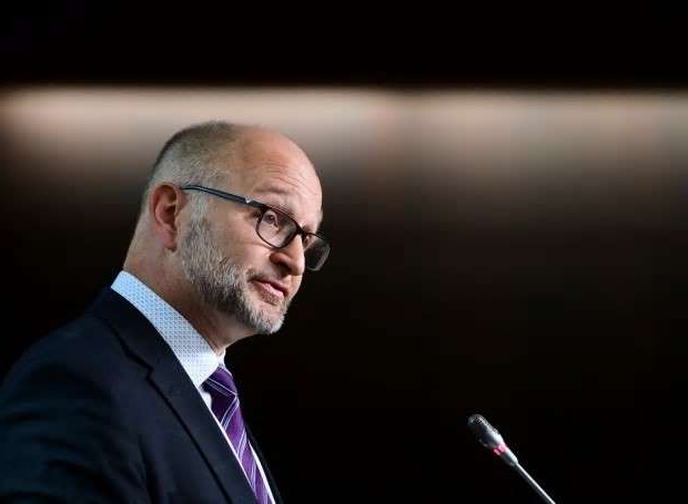 a man wearing a suit and tie: Justice Minister and Attorney General of Canada David Lametti insists the judicial appointments process is not being hijacked by partisan concerns.