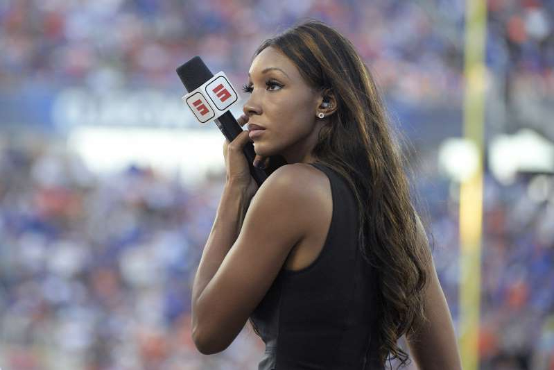a woman talking on a cell phone: Maria Taylor wrote that a viewer directed hate speech toward her family after her criticism of Jake Fromm. (AP Photo/Phelan M. Ebenhack)