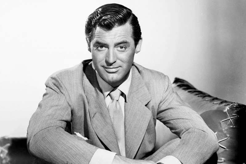 Cary Grant wearing a suit and tie: John Kobal Foundation/Getty Images