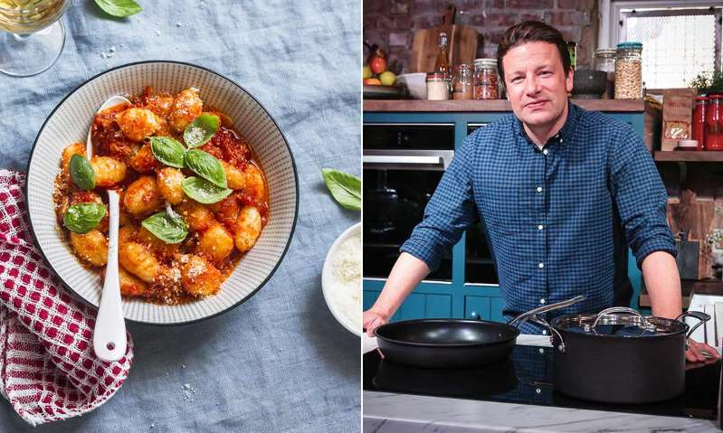 Jamie Oliver sitting at a table with a bowl of food: Hello! Magazine