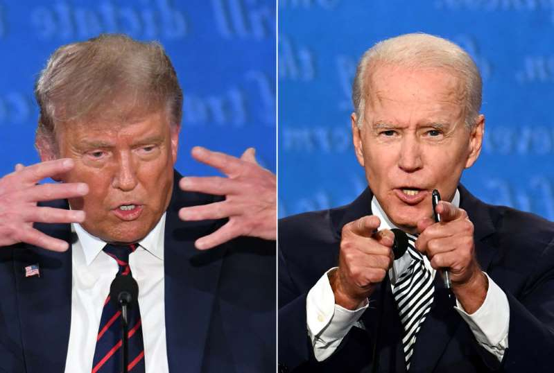Joe Biden, Donald Trump are posing for a picture: Democratic Presidential candidate and former US Vice President Joe Biden (L) and US President Donald Trump speaking during the first presidential debate at the Case Western Reserve University and Cleveland Clinic in Cleveland, Ohio on September 29, 2020.  Biden is favored to Trump in the latest European polls.