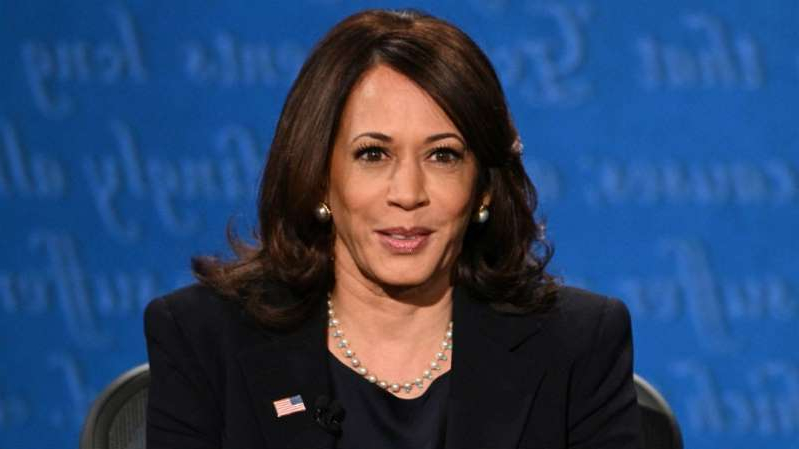 Kamala Harris holding a sign: As VP Kamal Harris could be a powerful voice for women's retirement security