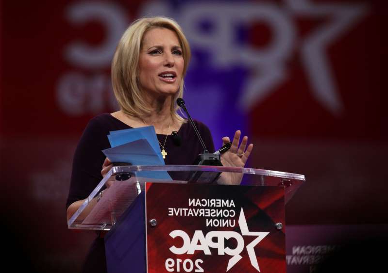 Laura Ingraham holding a sign: Talk show host Laura Ingraham speaks during CPAC 2019 February 28, 2019 in National Harbor, Maryland. The American Conservative Union hosts the annual Conservative Political Action Conference to discuss conservative agenda.