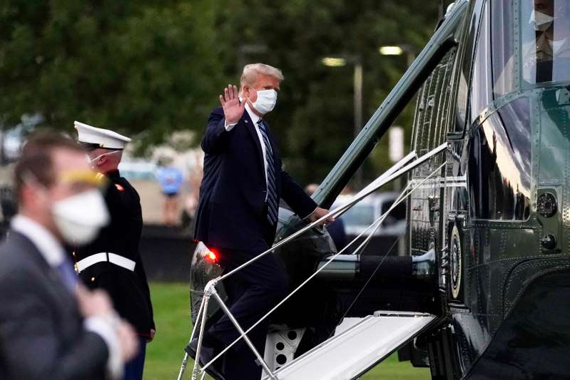 President Donald Trump boards Marine One to return to the White House after receiving treatments for covid-19 at Walter Reed National Military Medical Center, Monday, Oct. 5, 2020.