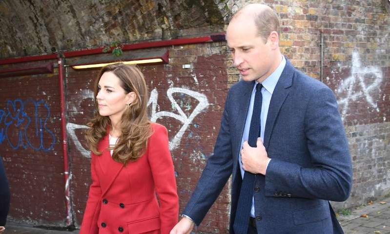Prince William, Duke of Cambridge standing in front of a building: Hello! Magazine