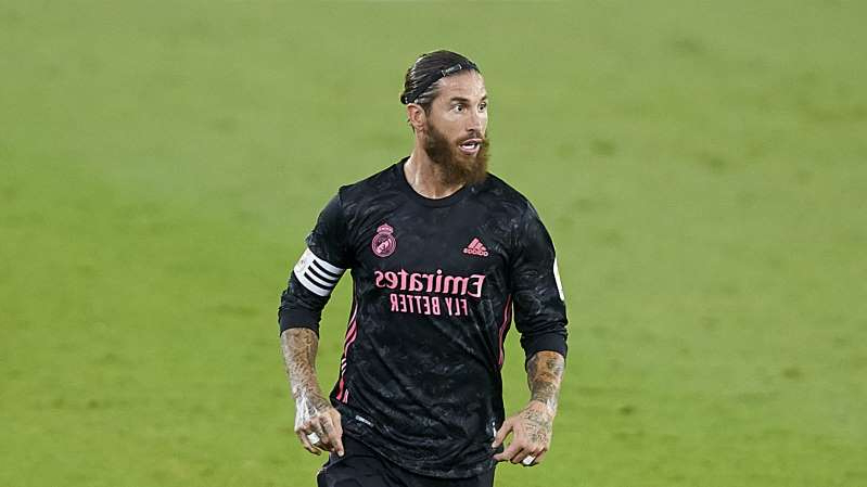 Sergio Ramos holding a green ball on a field: Real Madrid captain Sergio Ramos