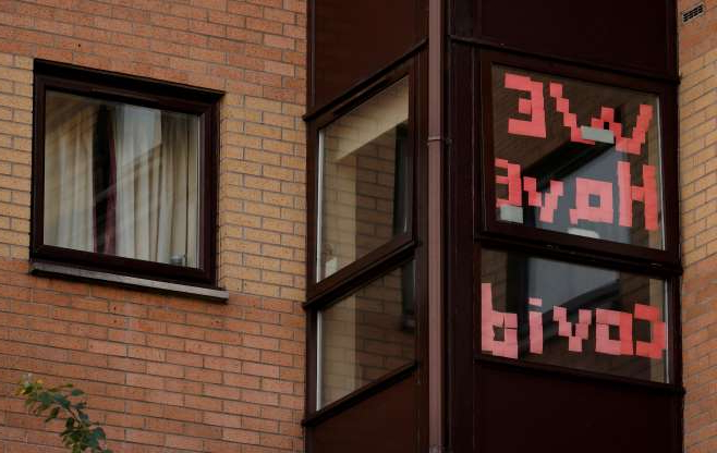 Slide 1 of 23: A sign is displayed in the window of a student accommodation building following the outbreak of the coronavirus disease (COVID-19) in Manchester, Britain, October 5, 2020. REUTERS/Phil Noble     TPX IMAGES OF THE DAY
