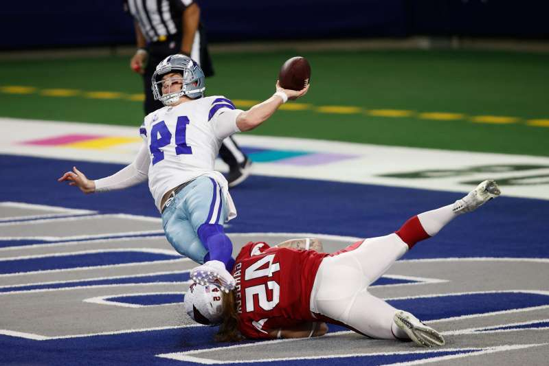 Arizona Cardinals linebacker Dennis Gardeck (45) tries to tackle Dallas Cowboys quarterback Andy Dalton (14) in the end zone in the first quarter at AT&T Stadium.