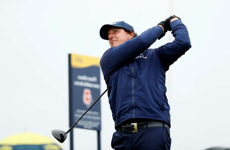 Phil Mickelson in a blue uniform holding a gun: The 148th Open Championship