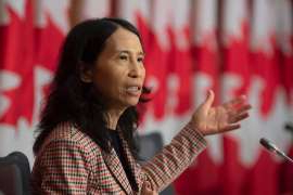 a woman holding a microphone: Canada's Chief Public Health Officer Theresa Tam responds to a question during a news conference on Oct. 20, 2020 in Ottawa.